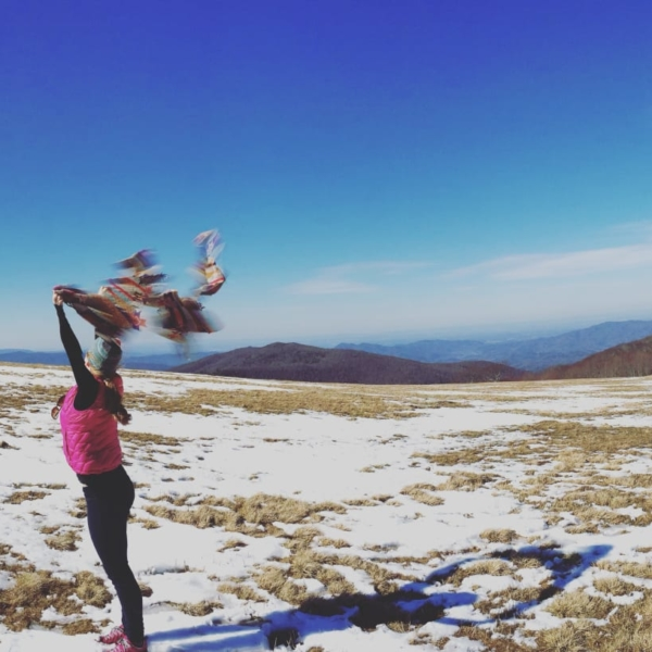 The grassy summit of Max Patch is a beautiful place to play in a windstorm.